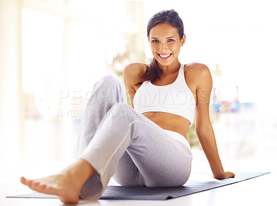 Buy stock photo Portrait of pretty young woman resting on fitness mat after exercising - Indoors