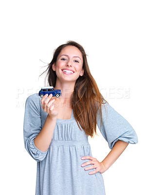 Buy stock photo Portrait of a happy young lady thinking to buy a new car against white background