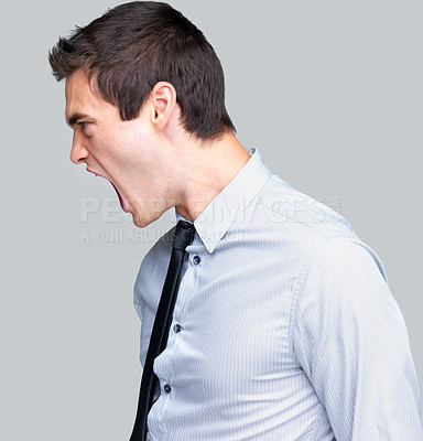 Buy stock photo Portrait of an excited young male entrepreneur shouting against grey background
