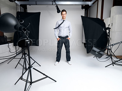 Buy stock photo Portrait of a successful young male fashion model standing in his studio