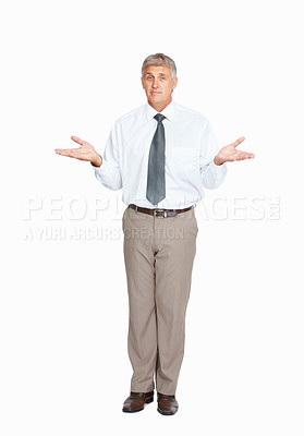 Buy stock photo Studio shot of a clueless mature businessman against a white background
