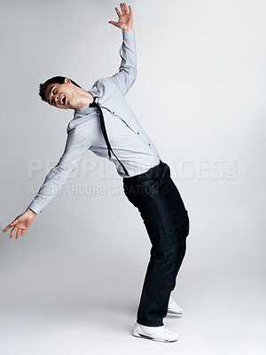 Buy stock photo Portrait of a psycho young male executive want to hit himself against grey background