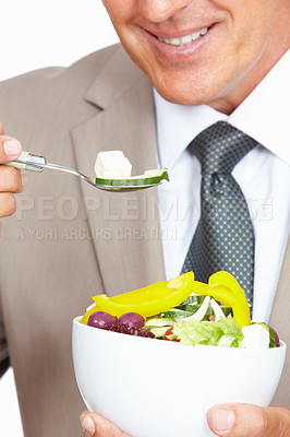 Buy stock photo Closeup shot of a businessman eating a healthy salad against a white background