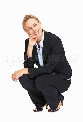 Buy stock photo Full length of happy business woman crouching on white background