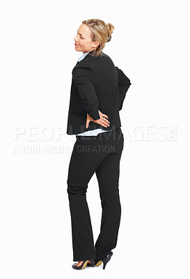Buy stock photo Full length of attractive female suffering from back pain on white background