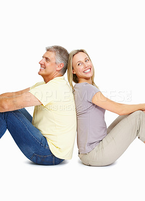 Buy stock photo Portrait of smiling happy mature couple sitting back to back on white background