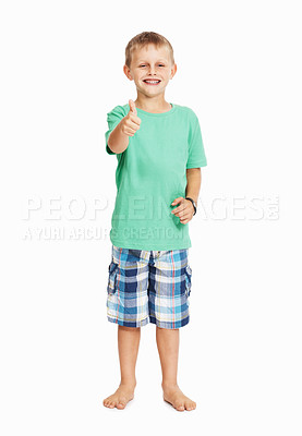 Buy stock photo Full length of young boy showing thumbs up over white background