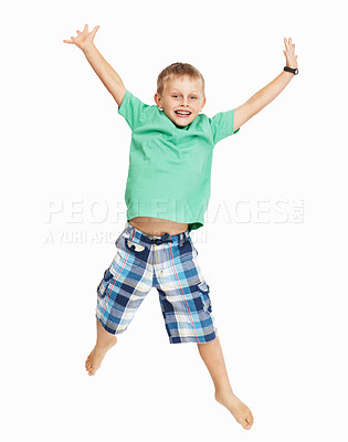 Buy stock photo Full length of happy young boy jumping in joy over white background