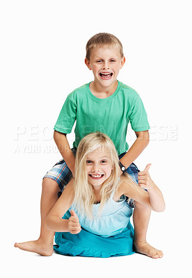 Buy stock photo Full length of young girl giving her brother a horse ride over white background