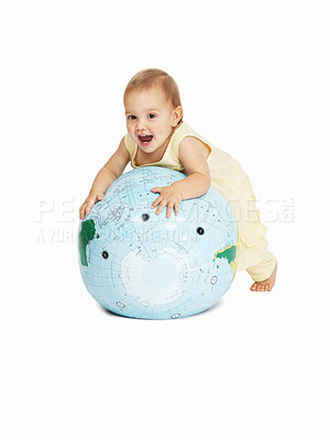 Buy stock photo Full-length of a cute baby playing with a globe isolated on a white background