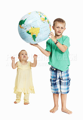Buy stock photo Full-length of young boy holding a globe with his sister trying reach it - Isolated
