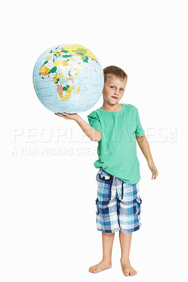 Buy stock photo Full length of young boy holding globe over white background