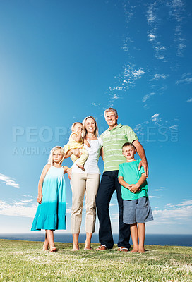 Buy stock photo Full length portrait of family having picnic at park