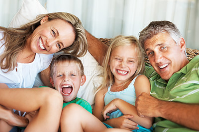 Buy stock photo Portrait of happy family spending time together at home