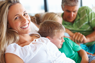 Buy stock photo Portrait of mature woman relaxing with family at home