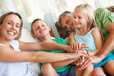 Buy stock photo Portrait of family keeping their hands one another at home