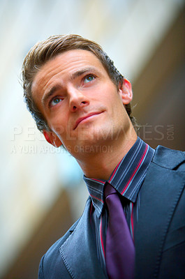 Buy stock photo Handsome young businessman looking away thoughtfully - closeup
