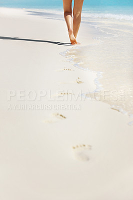Buy stock photo Cropped image of legs of beautiful young lady walking through the beach
