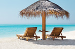 Relaxing chairs and umbrella on a beautiful beach