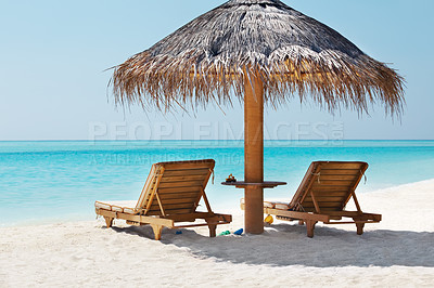 Buy stock photo An attractive image of beach with resting chair and shed