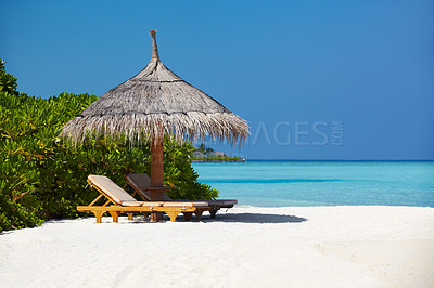 Buy stock photo Beautiful view of two chairs and a umbrella on the beach - Holiday