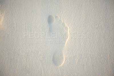 Buy stock photo Image of a single footprint of a human feet on pure white sand at beach