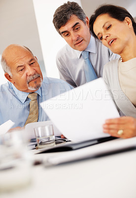 Buy stock photo Professional looking at business proposal