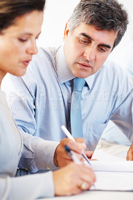 Buy stock photo Portrait of serious business man and woman signing document