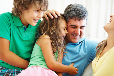 Buy stock photo Portrait of happy parents having fun with their children