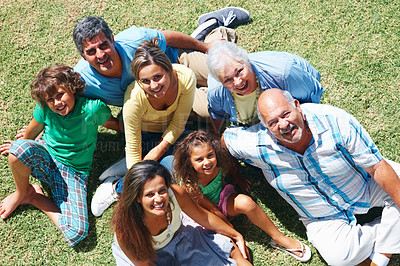 Buy stock photo Top view portrait of a three generation family relaxing on grass