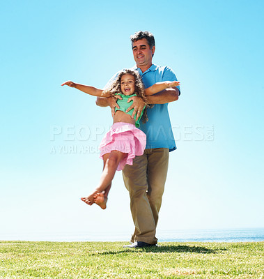 Buy stock photo Full length of father and his daughter playing together at a meadow