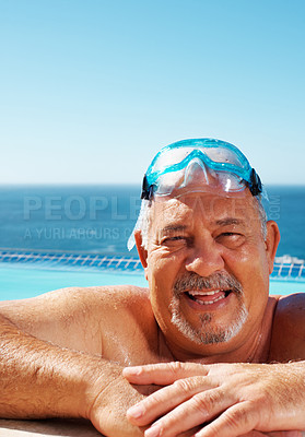 Buy stock photo Closeup of smiling senior man resting on the edge of swimming pool - copyspace