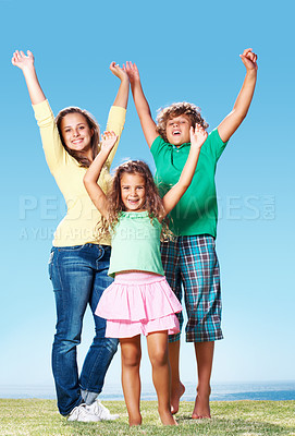 Buy stock photo Brother and sisters raising hands outdoors against clear blue sky