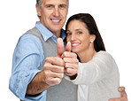 Cute mature couple gesturing thumbs up sign