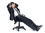 Relaxed young male executive sitting on a chair
