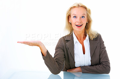 Buy stock photo Studio portrait of an attractive mature woman holding up copyspace isolated on white
