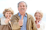 Group of happy old friends showing thumbs up sign