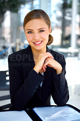 Buy stock photo Portrait of a young businesswoman looking through paperwork