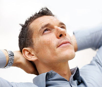 Buy stock photo Closeup portrait of a smart young man looking upwards and thinking about something