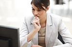 Beautiful business woman thinking while working at office