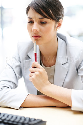 Buy stock photo Closeup portrait of a young business woman working at her office and thinking