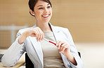 Smiling young business woman thinking about something