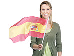 Smiling female with Spain's flag against white
