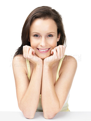 Buy stock photo Smiling and cute female sitting at a table isolated against white