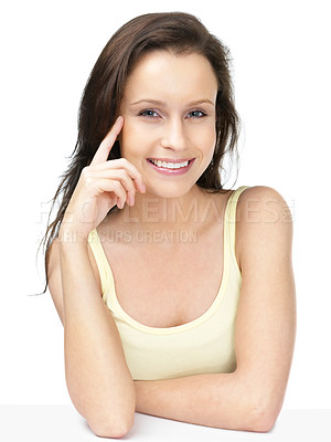 Buy stock photo Portrait of a casual cute female sitting at a table with a smile against white