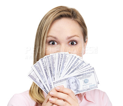 Buy stock photo Young woman holding a fan of currency notes isolated against white background