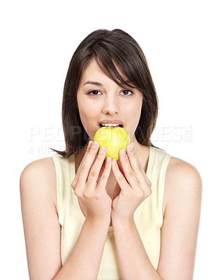 Buy stock photo Portrait of a pretty young woman eating an green apple on white background