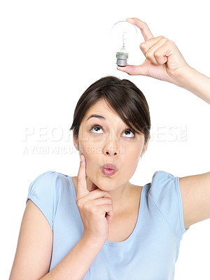 Buy stock photo Portrait of a cute young female holding bulb over head