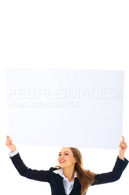 Buy stock photo Portrait of a beautiful business woman holding a blank billboard over her head. Lots of room for text and graphics. This isolate was taken in our studio.