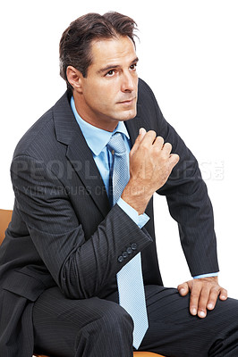 Buy stock photo A mature businessman sitting and looking thoughtful against a white background